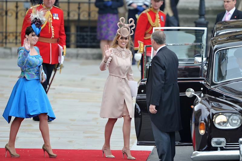 Princesses Beatrice and Eugenie were mocked for their unusual headgear at the 2011 royal wedding [Photo: Getty]