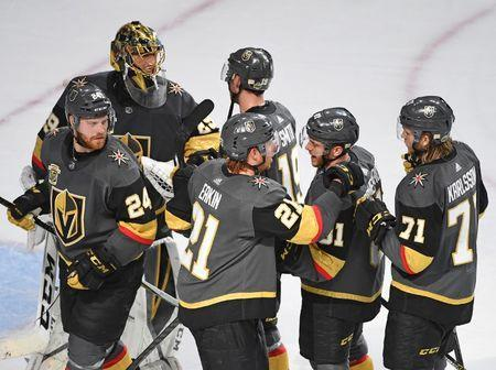 May 4, 2018; Las Vegas, NV, USA; Vegas Golden Knights players congratulate goaltender Marc-Andre Fleury (29) after defeating the San Jose Sharks 5-3 in game five of the second round of the 2018 Stanley Cup Playoffs at T-Mobile Arena. Mandatory Credit: Stephen R. Sylvanie-USA TODAY Sports