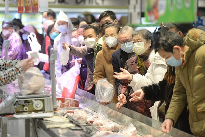 Customers wearing face masks inside a supermarket in Wuhan on February 10, 2020.