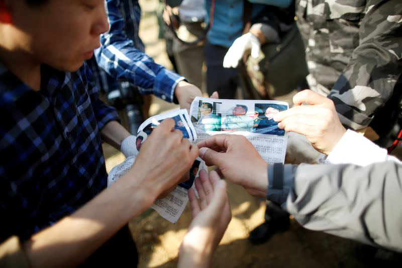 FILE PHOTO: Park Sang-hak, a North Korean defector and leader of an anti-North Korea civic group, shows leaflets denouncing North Korean leader Kim Jong Un to the media, near the demilitarized zone in Paju