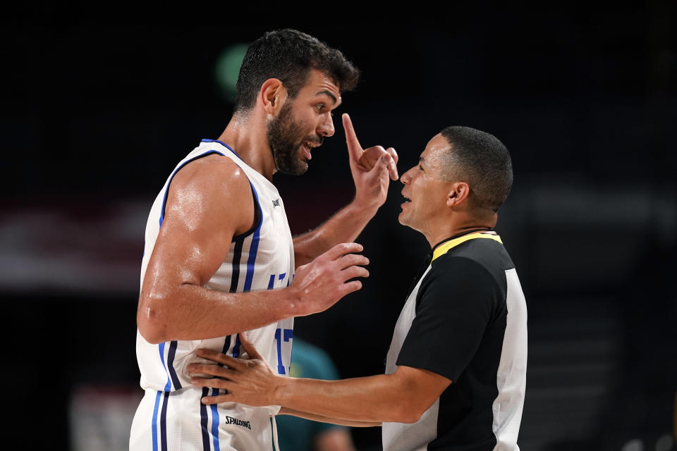Italy's Giampaolo Ricci (17) questions a foul call during a men's basketball preliminary round game against Australia at the 2020 Summer Olympics, Wednesday, July 28, 2021, in Saitama, Japan. (AP Photo/Charlie Neibergall)