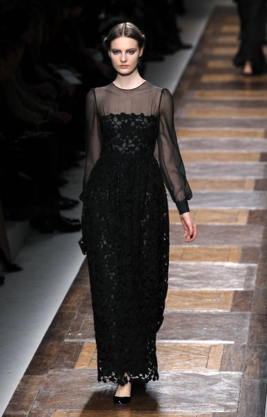 A model wears a creation by Maria Grazia Chiuri and Pier Paolo Piccioli for Valentino as part of the Fall-Winter, ready-to-wear 2013 fashion collection, during Paris Fashion week, Tuesday, March 6, 2012. (AP Photo/Christophe Ena)