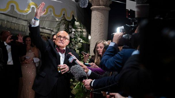 PHOTO: Former New York Mayor Rudy Giuliani, an attorney for President Donald Trump, speaks to reporters as he arrives for a New Year's Eve party hosted by President Donald Trump at his Mar-a-Lago property, Dec. 31, 2019, in Palm Beach, Fla. (Evan Vucci/AP)