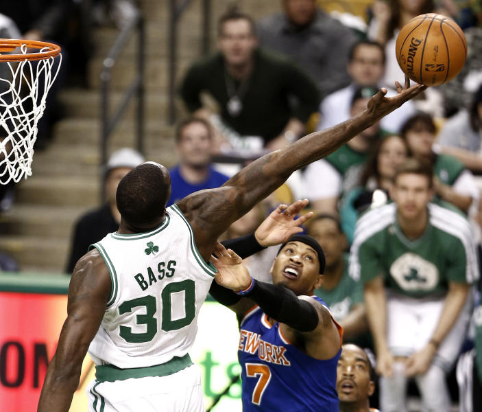 Boston Celtics' Brandon Bass (30) tries to get a rebound over New York Knicks' Carmelo Anthony during the second quarter of Game 3 of a first-round NBA basketball playoff series in Boston, Friday, April 26, 2013. (AP Photo/Winslow Townson)