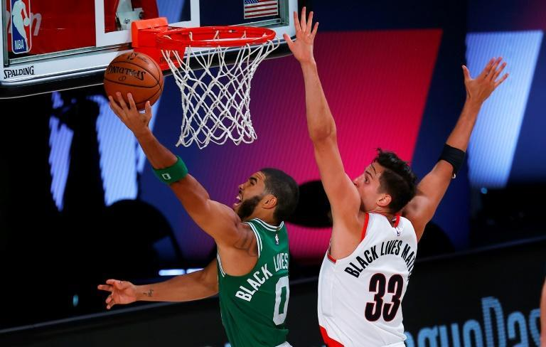 Jayson Tatum #0 of the Boston Celtics goes up for a shot against Zach Collins #33 of the Portland Trail Blazers (AFP Photo/Mike Ehrmann)