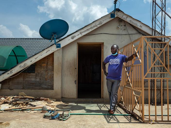 Image: Former Uber driver Harrison Munala on the rooftop of his former apartment building, where his wife and their three children were evicted from in mid-August after falling behind on their rent, in Nairobi's Kwangware neighborhood, Kenya (Nichole Sobecki / for NBC News)