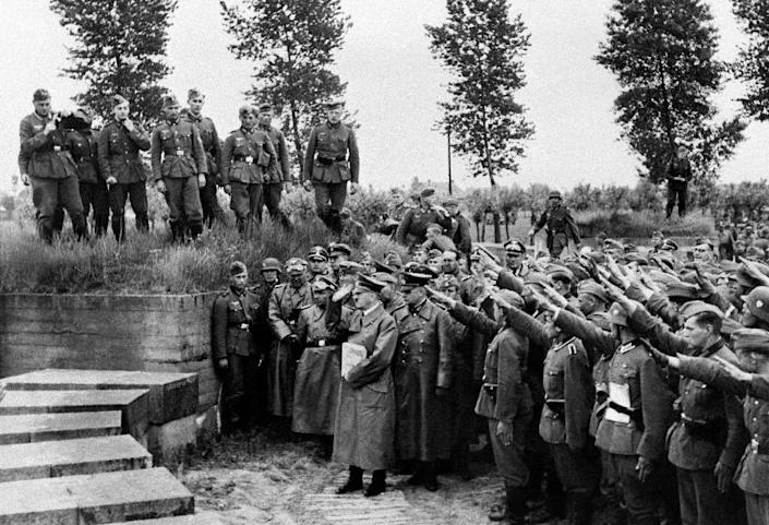 Adolf Hitler pays tribute to German soldiers fallen during World War I, during a 1940 visit to the Langemark cemetery in Belgium (AFP Photo/)