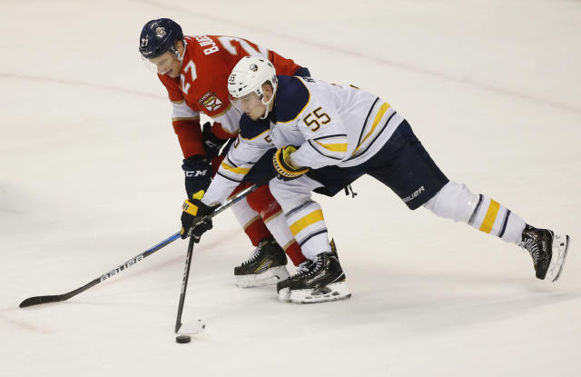 Buffalo Sabres defenseman Rasmus Ristolainen (55) and Florida Panthers center Nick Bjugstad (27) battle for the puck during the second period of an NHL hockey game, Friday, March 2, 2018, in Sunrise, Fla. (AP Photo/Wilfredo Lee)