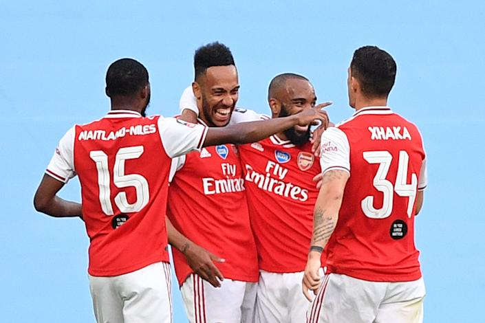 Pierre-Emerick Aubameyang (second from left) scored on either side of halftime as Arsenal upset Manchester City and advanced to next month's FA Cup final. (Justin Tallis/Getty Images)