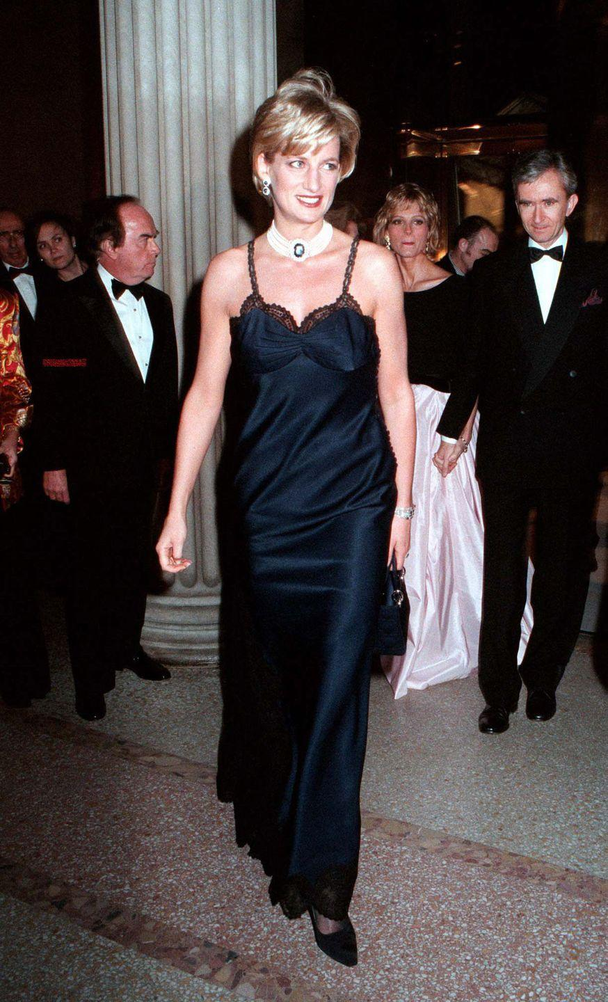 <p>In a lacy black dress and white choker at the 50th Anniversary celebrations for Dior in New York. </p>