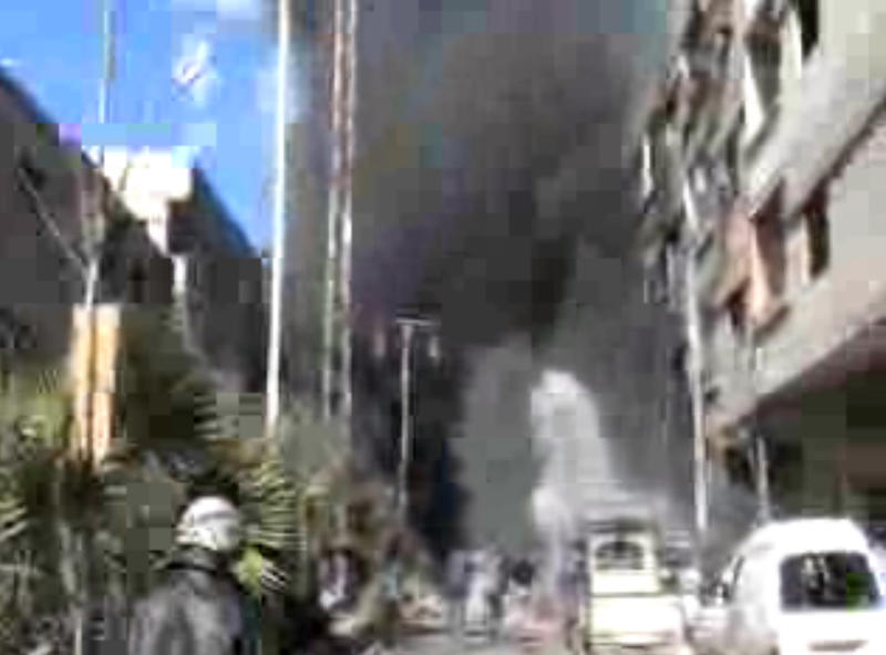 This image taken from video obtained from Bambuser, which has been authenticated based on its contents and other AP reporting, shows smoke and fire after a fighter jet crashed into a suburb of Damascus, Syria, Wednesday, Feb. 20, 2013. The United Nations says at least 70,000 people have been killed since the conflict began in March 2011 as an uprising against Bashar Assad's rule. The revolt turned into a civil war that has taken increasingly sectarian overtones with mostly Sunni Muslim opposition forces fighting to topple the regime dominated by Alawites, an offshoot Shiite group.(AP Photo/Bambuser, SNN Hamouria via AP video)