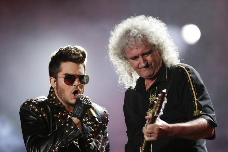 FILE - In this Sept. 19, 2015 file photo, Adam Lambert, left, and Brian May of the Queen + Adam Lambert perform at the Rock in Rio music festival in Rio de Janeiro, Brazil. Many of the rock 'n' roll bands that were huge in 1977 will comprise a big part of the summer concert market 40 years later. Concert industry executives say nostalgia acts are still reliable sellers, with satellite and classic rock radio keeping their hits alive. (AP Photo/Felipe Dana, File)