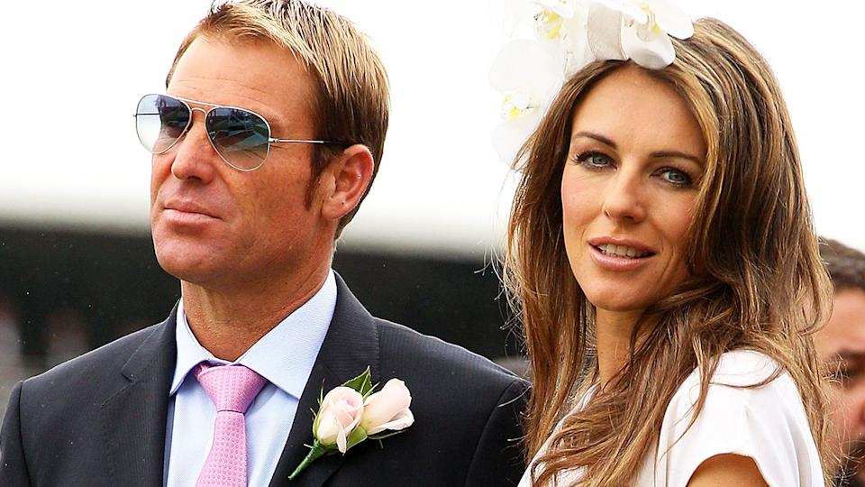 Shane Warne and LIz Hurley, pictured here at Flemington Racecourse in 2011.