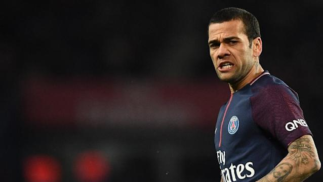 Dani Alves, pictured in December 2017, was shown a straight red card early in the second half of PSG's 2-1 defeat in Lyon (AFP Photo/FRANCK FIFE)