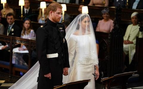Prince Harry and Meghan Markle in St George's Chapel at Windsor Castle - Credit: PA