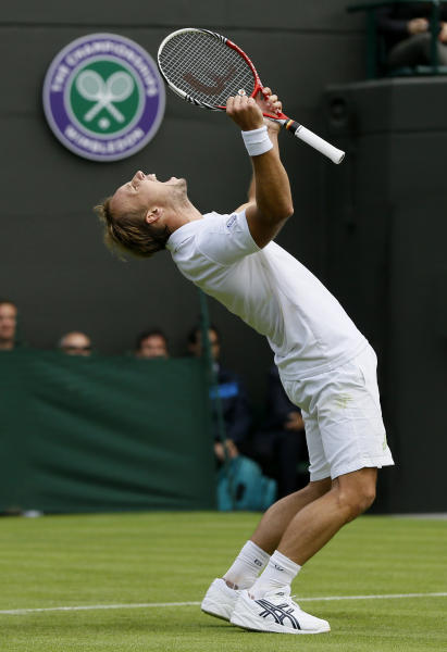 Steve Darcis of Belgium reacts as he defeats Rafael Nadal of Spain in their Men's first round singles match at the All England Lawn Tennis Championships in Wimbledon, London, Monday, June 24, 2013. (AP Photo/Kirsty Wigglesworth)