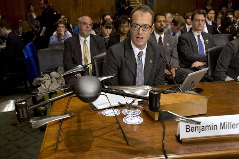 Mesa County, Colo., Sheriffs Office Unmanned Aircraft Program Manager Benjamin Miller, testifies on Capitol Hill in Washington, Wednesday March 20, 2013, in front of an example of a drone, before a Senate Judiciary Committee hearing to examine the future of drones in America, focusing on law enforcement and privacy considerations. (AP Photo/Jacquelyn Martin)