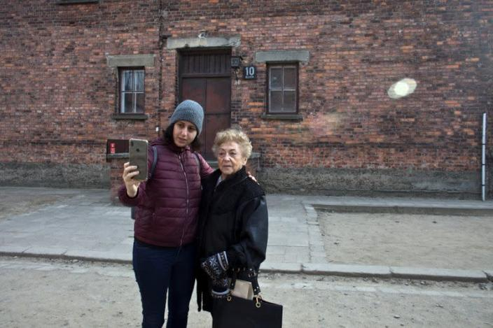 Lee Aldar the granddaughter of Jona Laks takes a selfie of them during a visit in the Auschwitz death camp in Oswiecim