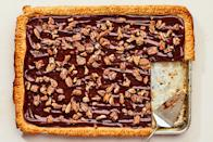 """The pleasant, earthy bitterness of molasses balances a typically too-sweet pecan pie filling for this sheet-pan pie. You can make it a day before you plan to serve it. <a href=""""https://www.epicurious.com/recipes/food/views/chocolate-pecan-sheet-pie-with-molasses?mbid=synd_yahoo_rss"""" rel=""""nofollow noopener"""" target=""""_blank"""" data-ylk=""""slk:See recipe."""" class=""""link rapid-noclick-resp"""">See recipe.</a>"""