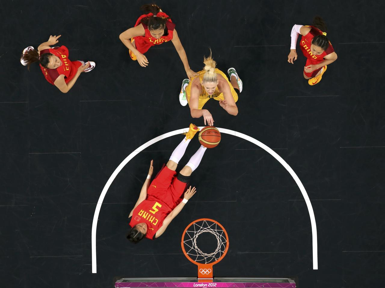 Australia's Lauren Jackson (15) shoots over China's Xiaoyun Song (5) in the women's quarterfinal basketball match at the Basketball Arena in London during the London 2012 Olympic Games August 7, 2012.  REUTERS/Mike Segar (BRITAIN  - Tags: OLYMPICS SPORT BASKETBALL TPX IMAGES OF THE DAY)