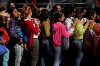 Women queue on the street as they try to buy diapers outside a pharmacy in Caracas, Venezuela March 18, 2017. REUTERS/Carlos Garcia Rawlins