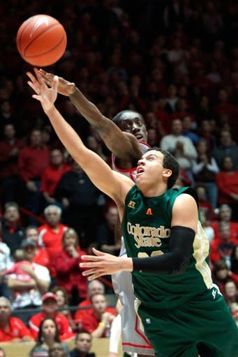 Colorado State's Dorian Green attempts a layup against New Mexico's Tony Snell, rear, during the second half of their NCAA college basketball game in Albuquerque, N.M., Wednesday, Jan. 23, 2013. New Mexico won 66-61. (AP Photo/Eric Draper)
