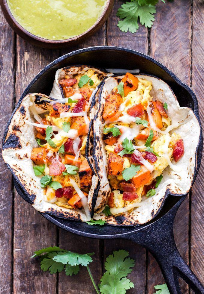 """<p>Top off these tacos with avocado, salsa, and sour cream.</p><p><strong>Get the recipe at <a href=""""https://reciperunner.com/sweet-potato-bacon-and-egg-breakfast-tacos/"""" rel=""""nofollow noopener"""" target=""""_blank"""" data-ylk=""""slk:Recipe Runner"""" class=""""link rapid-noclick-resp"""">Recipe Runner</a>.</strong></p><p><a class=""""link rapid-noclick-resp"""" href=""""https://www.amazon.com/Home-table-folding-breakfast-Bamboo/dp/B00PHS97EU/?tag=syn-yahoo-20&ascsubtag=%5Bartid%7C10050.g.1681%5Bsrc%7Cyahoo-us"""" rel=""""nofollow noopener"""" target=""""_blank"""" data-ylk=""""slk:SHOP BREAKFAST TRAYS"""">SHOP BREAKFAST TRAYS</a></p>"""