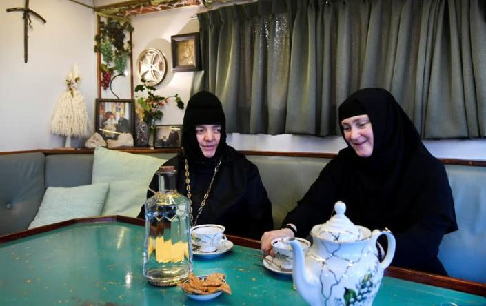 Two nuns sits in the livingroom of a mobile Georgian Orthodox monastery in Vlissingen