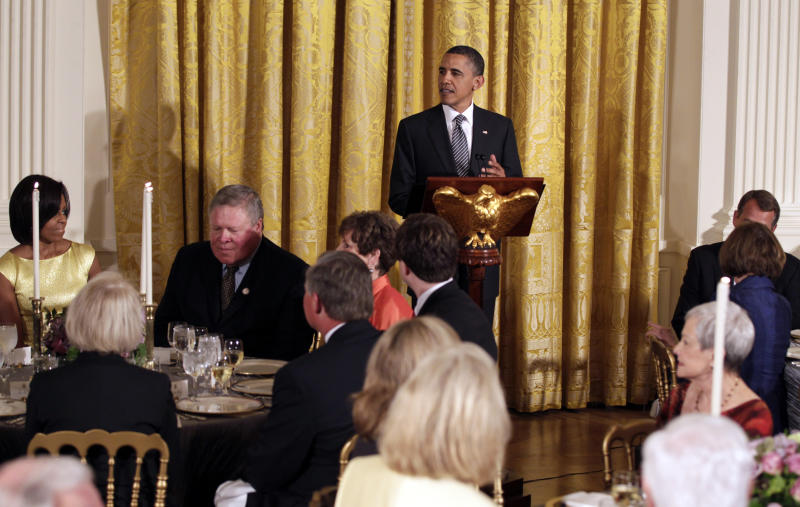 President Barack Obama speaks during a dinner for a group of bipartisan Congressional leaders and ranking members and their spouses at the White House, Monday, May 2, 2011, in Washington. Seated far left is first lady Michelle Obama and far right are House Speaker John Boehner of Ohio and House Minority Leader Nancy Pelosi of Calif. (AP Photo/Carolyn Kaster)