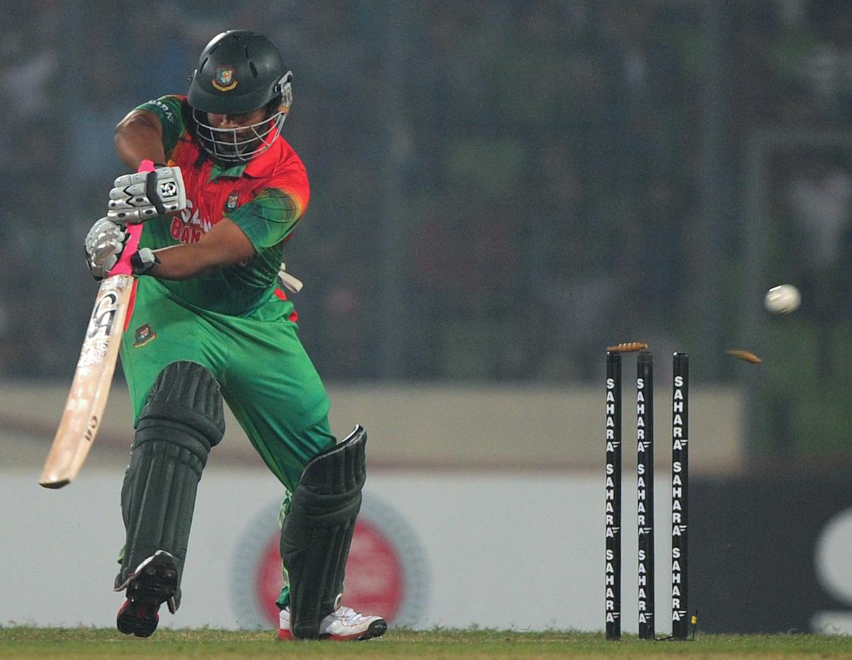 Bangladeshi batsman Tamim Iqbal is bowled by West Indies cricketer Kemar Roach during the fourth one day international cricket match between Bangladesh and the West Indies at The Sher-e-Bangla National Cricket Stadium in Dhaka on December 7, 2012. AFP PHOTO/ Munir uz ZAMAN