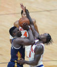 New Orleans Pelicans forward Zion Williamson is fouled has he goes to the basket against New York Knicks forward Julius Randle in the second half of an NBA basketball game in New Orleans, Wednesday, April 14, 2021. The Knicks won 116-106. (AP Photo/Gerald Herbert)