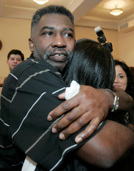 FILE-In this Friday, Feb. 15, 2008 file photo shows Levon Brooks, left, huging a friend, moments after a circuit court judge released him pending a new trial for the murder of a child in Macon, Miss. Brooks was convicted in 1992 of raping and killing his ex-girlfriend's 3-year-old daughter and sentenced to life in prison. Since 2000, at least 18 men convicted in rapes and murders largely because of bite-mark analysis have been exonerated by DNA testing or otherwise proved not guilty. (AP Photo/Rogelio V. Solis, file)