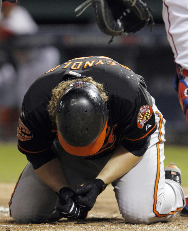Baltimore Orioles' Mark Reynolds checks his hand after being hit by a pitch from Texas Rangers starter Yu Darvish during the second inning of an American League wild-card playoff baseball game Friday, Oct. 5, 2012, in Arlington, Texas. (AP Photo/LM Otero)