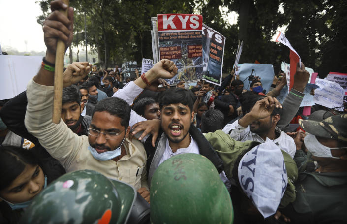 Security officers, in the foreground, push back people shouting slogans during a demonstration held in support to farmers who have been on a months-long protest, in New Delhi, India, February 3, 2021. / Credit: Manish Swarup/AP