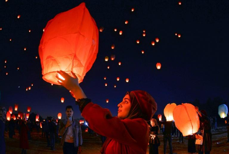 Iraqis in the holy shrine city of Najaf launch rice paper hot air balloons in December 2019 to show their solidarity with anti-government protests across the country