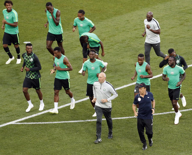 Nigeria's coach Gernot Rohr, front right, runs with his players during Nigeria's official training on the eve of the group D match between Nigeria and Iceland at the 2018 soccer World Cup in the Volgograd Arena, in Volgograd, Russia, Thursday, June 21, 2018. (AP Photo/Darko Vojinovic)