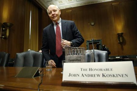 Koskinen takes his seat to testify before a Senate Finance Committee confirmation hearing on his nomination to be commissioner of the Internal Revenue Service (IRS) on Capitol Hill in Washington