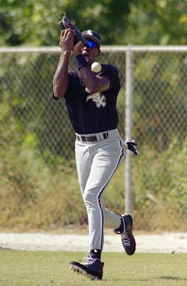 Michael Jordan drops a fly ball during the first day of practice at the Chicago White Sox's Instructional League in Sarasota, Fla., Sept. 23, 19 (AP Photo/Chris O'Meara)