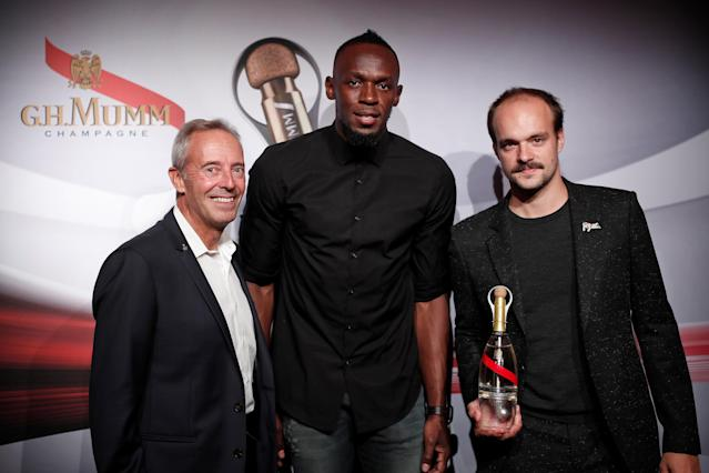 Retired sprinter Usain Bolt, French astronaut Jean-Francois Clervoy, CEO of Novespace, and French Interior designer Octave de Gaulle who designed a bottle of Mumm Grand Cordon Stellar champagne pose after a zero gravity conditions flight in a specially modified plane above Reims, France, September 12, 2018. Picture taken September 12, 2018. REUTERS/Benoit Tessier