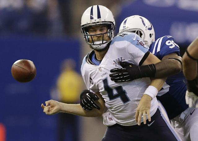 Tennessee Titans' Ryan Fitzpatrick (4) is sacked by Indianapolis Colts' Robert Mathis (98) during the second half of an NFL football game on Sunday, Dec. 1, 2013, in Indianapolis. The Colts recovered the fumble. (AP Photo/Michael Conroy)