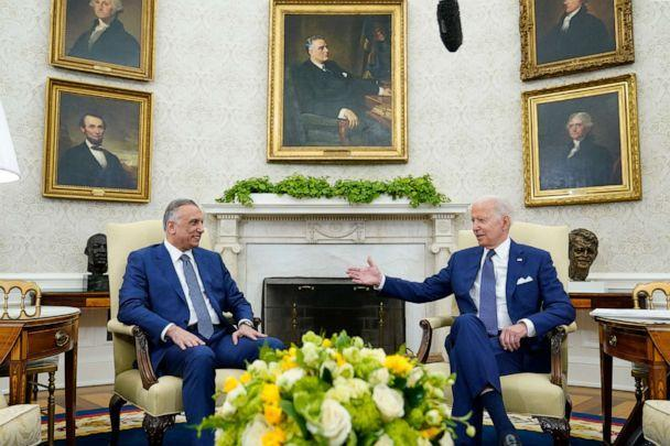 PHOTO: President Joe Biden, right, meets with Iraqi Prime Minister Mustafa al-Kadhimi, left, in the Oval Office of the White House, July 26, 2021.  (Susan Walsh/AP)