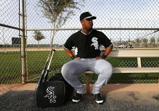 Chicago White Sox's Jose Abreu sits in the dugout during spring training baseball practice in Glendale, Ariz., Wednesday, Feb. 19, 2014. (AP Photo/Paul Sancya)