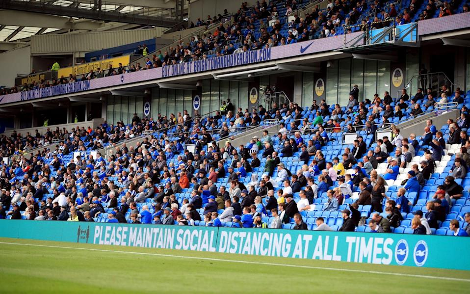 Brighton and Hove Albion fans adhering to social distancing during a return to stadiums test eve - PA