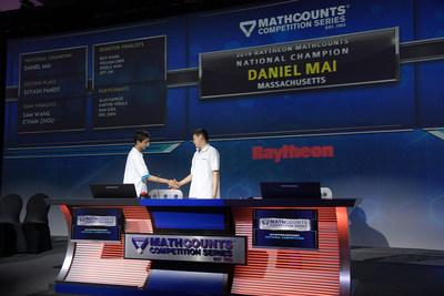 2019 Raytheon MATHCOUNTS National Competition winner Daniel Mai, right, shakes hands with runner-up Suyash Pandit after winning Monday, May 13, 2019, in Orlando, Fla. (Phelan M. Ebenhack for The Raytheon Company)
