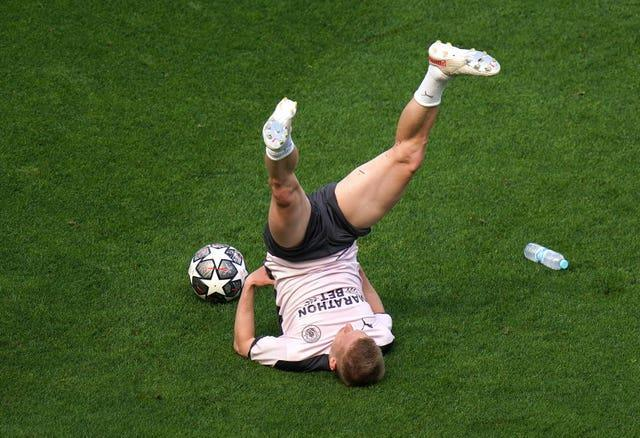 Kevin De Bruyne stretches during a training session on Friday
