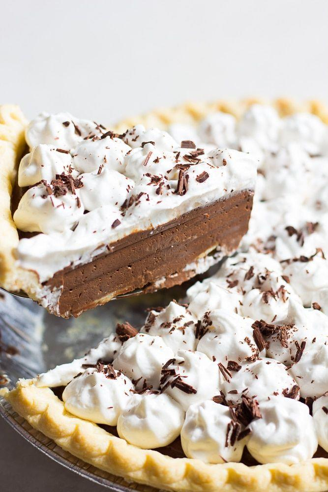 "<p>To cover all the bases (a.k.a. make all the family members happy), add this silky smooth chocolate pie to your dessert spread. </p><p><em><a href=""https://www.noracooks.com/healthier-chocolate-cream-pie/"" rel=""nofollow noopener"" target=""_blank"" data-ylk=""slk:Get the recipe at Nora Cooks »"" class=""link rapid-noclick-resp"">Get the recipe at Nora Cooks »</a></em> </p><p><strong>RELATED: </strong><a href=""https://www.goodhousekeeping.com/food-recipes/dessert/g32305125/easy-chocolate-desserts/"" rel=""nofollow noopener"" target=""_blank"" data-ylk=""slk:25 Easy and Creative Chocolate Desserts That You Haven't Tried Yet"" class=""link rapid-noclick-resp"">25 Easy and Creative Chocolate Desserts That You Haven't Tried Yet</a></p>"