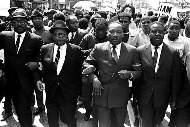 King is flanked by Abernathy, right, and Bishop Julian Smith, left, during a civil rights march in Memphis on March 28, 1968. (Photo: Jack Thornell/AP)