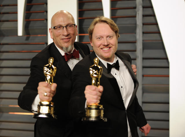 """Roy Conli, left, and Don Hall pose backstage with their award for best animated feature film for """"Big Hero 6"""" arrives at the 2015 Vanity Fair Oscar Party on Sunday, Feb. 22, 2015, in Beverly Hills, Calif. (Photo by Evan Agostini/Invision/AP)"""