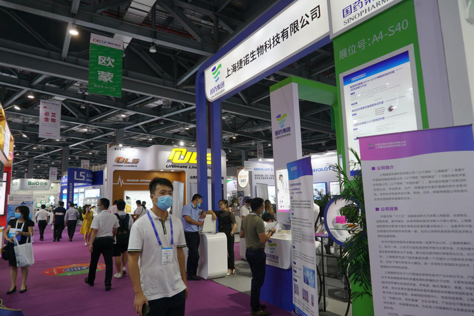 Shanghai-based testing kit company GeneoDx presents a booth at a trade fair in Nanchang in eastern China's Jiangxi province on Saturday, Aug. 22, 2020. GeneoDx was one of three companies that gained privileged access to crucial information on the coronavirus from the Chinese Center for Disease Control and Prevention at the beginning of the outbreak, allowing them to make kits ahead of competitors. The move delayed China's response to the outbreak and caused critical shortages of kits. (AP Photo/Dake Kang)
