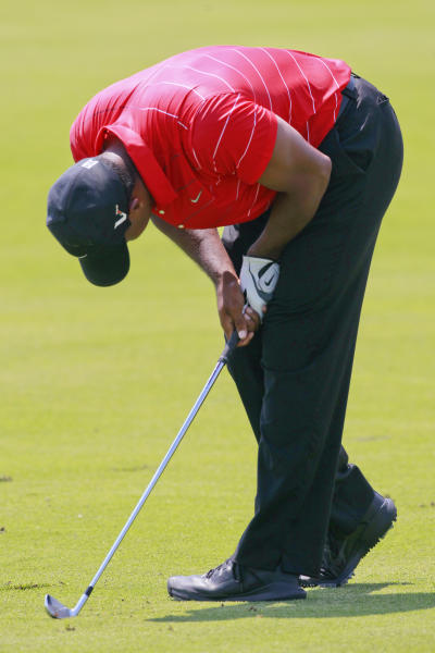 Tiger Woods reacts to his fairway shot on the fourth hole during the final round of the PGA Championship golf tournament on the Ocean Course of the Kiawah Island Golf Resort in Kiawah Island, S.C., Sunday, Aug. 12, 2012. (AP Photo/John Raoux)